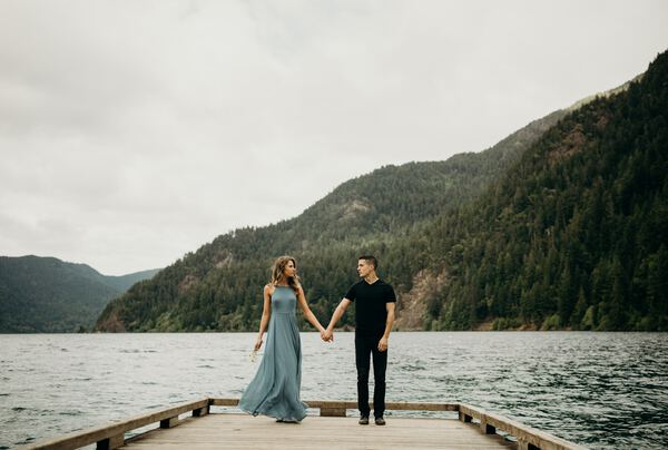 Couple holding hands on a dock